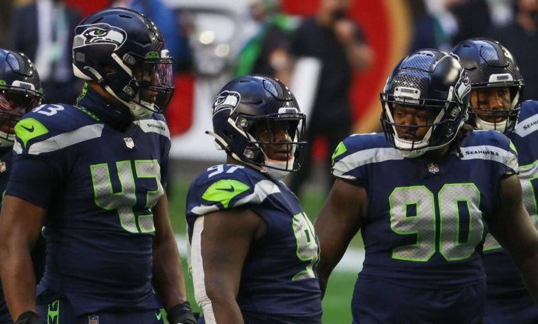 Seattle Seahawks re-sign Carlos Dunlap; Jarran Reed expected to be released or traded