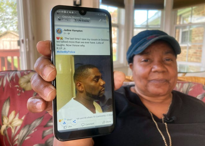 Glenda Brown Thomas displays a photo of her nephew, Andrew Brown Jr., on her cellphone on Thursday.