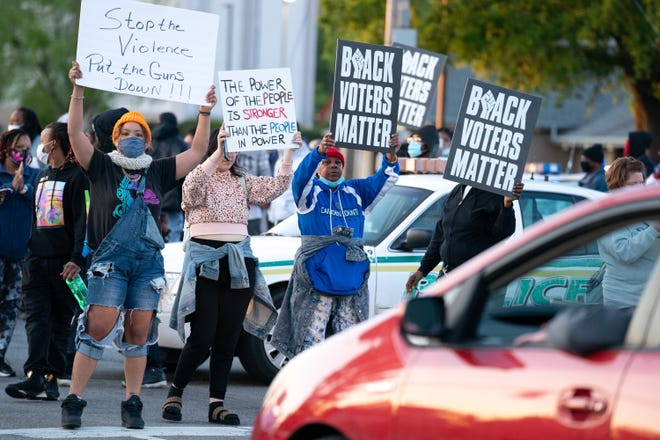 Demonstrators block an intersection during a protest march on April 22, 2021 in Elizabeth City, North Carolina. The protest was sparked by the police killing of Andrew Brown Jr. on April 21.