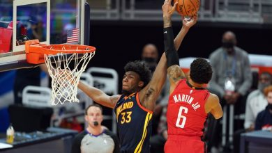 Golden State Warriors' James Wiseman leaves with knee injury after hard fall