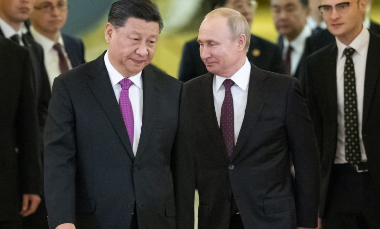 Leaders of Russia and China tighten their grips, grow closer