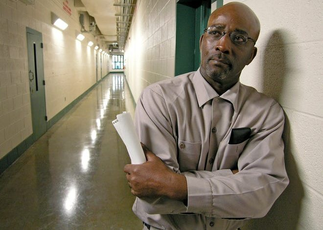 In this 2007 file photo, Ronnie Long stands in a hallway at the Albemarle Correctional Institution in Albemarle, east of Charlotte, N.C.