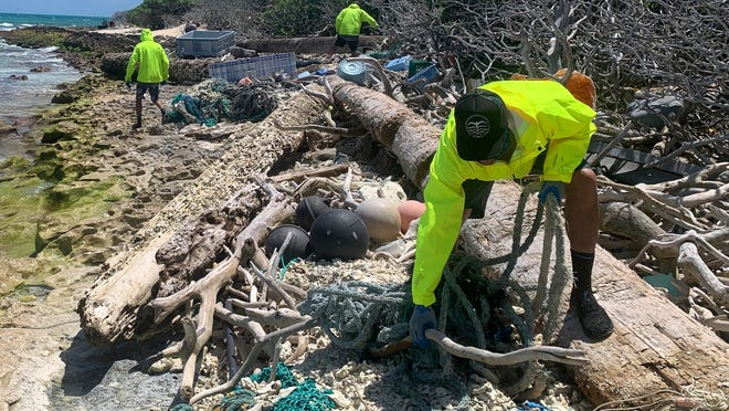 Scientists haul over 47 tons of ocean debris out of Hawaii atolls