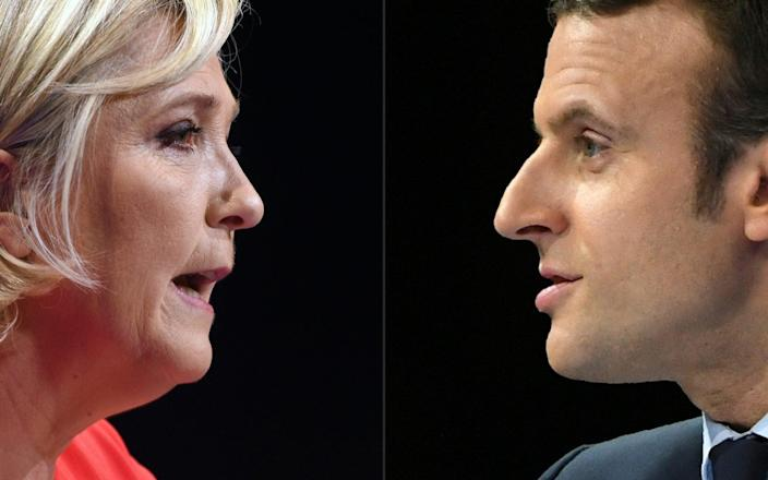 French far-right National Rally party leader Marine Le Pen (L) and French president Emmanuel Macron are polling to clash in next year's elections -  GUILLAUME SOUVANT/ AFP