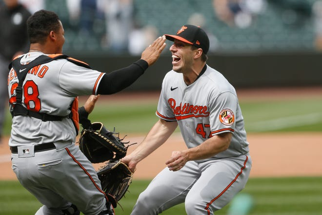 Orioles pitcher John Means, right, celebrates the final out of his no-hitter against the Mariners with catcher Pedro Severino.