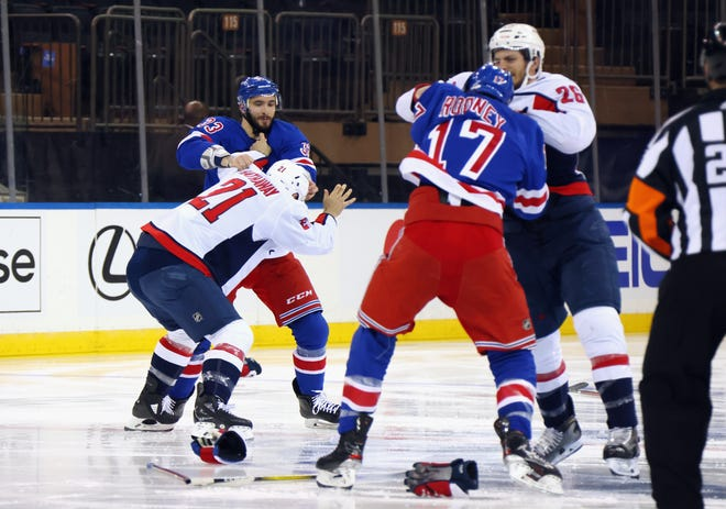 The game between the Washington Capitals and the New York Rangers starts with a line brawl one second into play at Madison Square Garden.