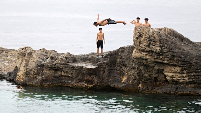 A man diving into the sea in Tripoli, Libya - Friday 30 April 2021