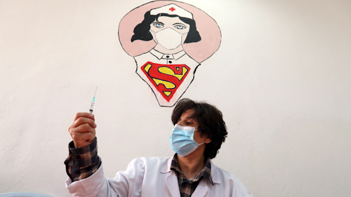 A nurse holding up a syringe in Tunis, Tunisia - Monday 3 May 2021