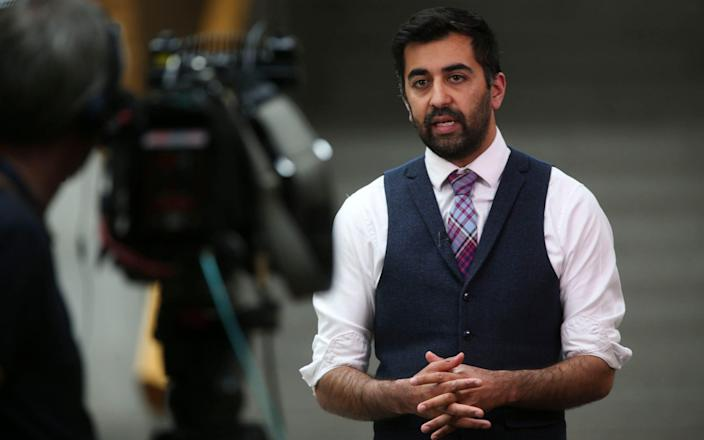 Cabinet Secretary for Justice Humza Yousaf MS speaks to media in the Scottish Parliament, Edinburgh today - Fraser Bremner/Scottish Daily Mail