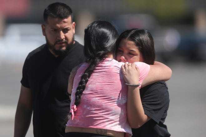 People embrace after a school shooting at Rigby Middle School in Rigby, Idaho on Thursday, May 6, 2021. Authorities say a shooting at the eastern Idaho middle school has injured two students and a custodian, and a female student has been taken into custody.