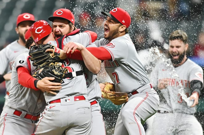 Reds starter Wade Miley, center, and catcher Tucker Barnhart are swarmed by teammates after Miley threw a no-hitter against Cleveland in Cincinnati's 3-0 win.