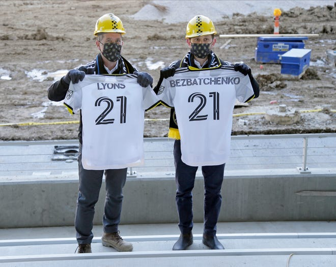 Tim Bezbatchenko, Crew SC President & General Manager, and Steve Lyons, Crew SC Executive Vice President Chief Business Officer, pose with jerseys as Columbus Crew SC unveiled its primary kit for the 2021 season at an event held at the New Crew Stadium.