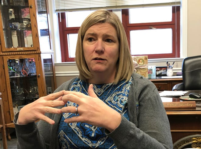 FILE—In this Dec. 19, 2019 file photo, Dayton mayor Nan Whaley talks in her office in Dayton, Ohio. Whaley announced Monday April 19, 2021, she will try to unseat Ohio's Republican governor after her effort to work with him on gun reforms in the aftermath of a mass shooting in her city stalled.