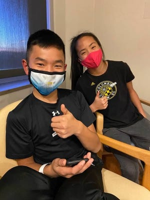 Siblings Sam, 12, and Audrey Baker, 15, of Cincinnati were both part of the Pfizer-BioNTech vaccine trial for adolescents.