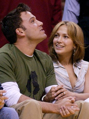ActorsBen Affleck and Jennifer Lopez sit together during Game 4 of the Western Conference Semifinals between the Los Angeles Lakers and the San Antonio Spurs, May 11, 2003, in Los Angeles.