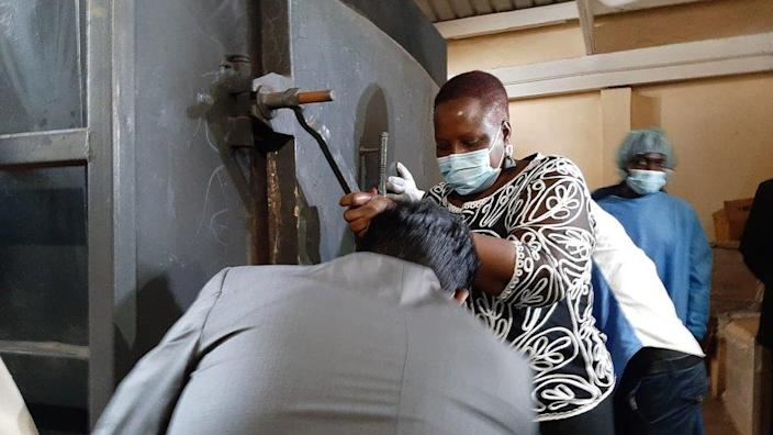 Malawi's Health Minister Khumbize Chiponda was photographed closing the incineration chamber on Wednesday