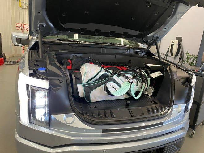 The 2022 Ford F-150 Lightning electric pickup's 400L front storage compartment has room for two standard golf bags, plus drainable under floor storage.