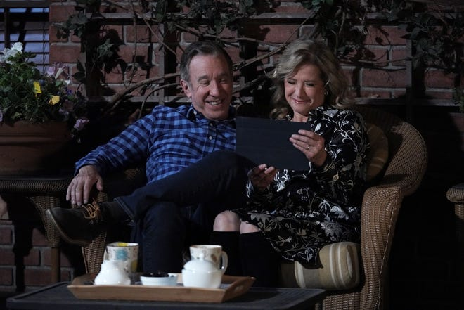 """Mike (Tim Allen), left, and Vanessa (Nancy Travis) enjoy a happy moment talking to daughter Eve via tablet in the series finale of Fox's """"Last Man Standing."""""""