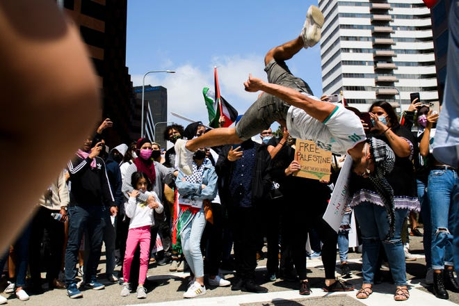A demonstrator performs a backflip outside the Consulate of Israel during a demonstration in support of Palestine during the Los Angeles Nakba 73: Resistance Until Liberation rally and protest on May 15, 2021, in Los Angeles.