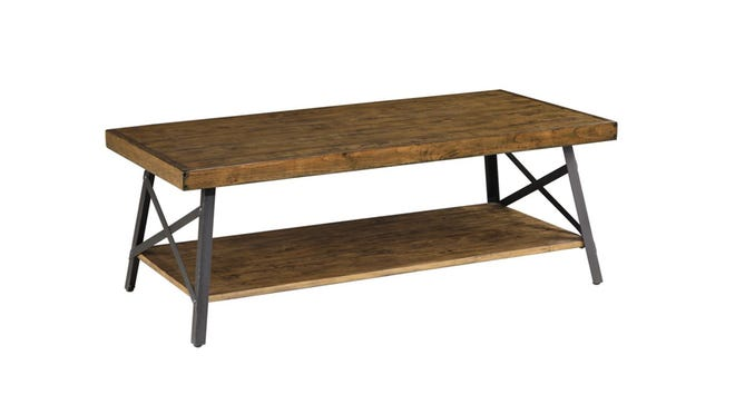 This farmhouse-inspired coffee table boasts plenty of storage for décor.