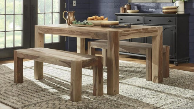 The natural wood finish of this dining room table is absolutely gorgeous.