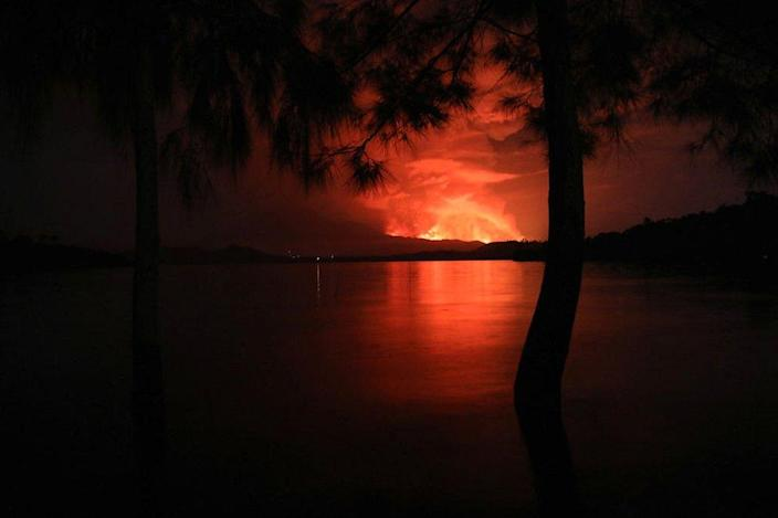 This general view taken on 22 May 2021 from Tchegera Island outside Goma on the lake Kivu in the East of the Democratic Republic of Congo shows flame spewing from the Nyiragongo volcano.