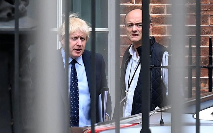 FILES) In this file photo taken on September 03, 2019 Britain's Prime Minister Boris Johnson (L) and his special advisor Dominic Cummings leave from the rear of Downing Street in central London, before heading to the Houses of Parliament. - British Prime Minister Boris Johnson faced growing scrutiny on April 25, 2021, following explosive accusations by his former chief aide Dominic Cummings earlier this week that he lacks competence and integrity. - DANIEL LEAL-OLIVAS/AFP via Getty Images