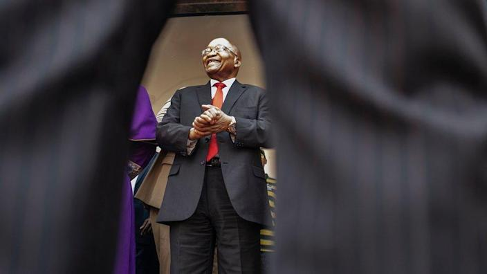 Former South African president Jacob Zuma greets a crowd of supporters before addressing them outside the KwaZulu-Natal High Court in Durban on 6 April 2018