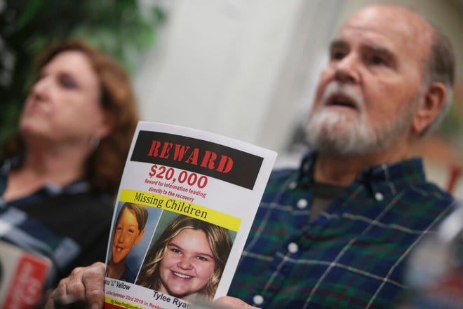 """Kate and Larry Woodcock speak to reporters at the Rexburg Standard Journal Newspaper in Rexburg, Idaho, on Jan. 7, 2020. The Woodcocks are offering $20,000 for information that leads to the recovery of Joshua """"JJ"""" Vallow and Tylee Ryan. Joshua Vallow and Ryan were last seen Sept. 23, 2019."""