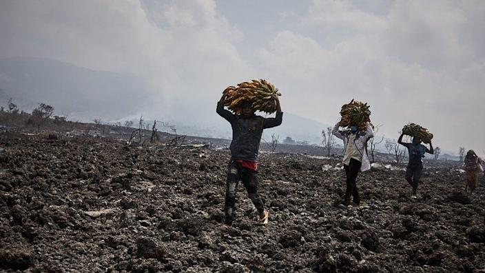 Congolese communities walking across lava flows in Kibati, North of the city of Goma, in the aftermath of a volcanic eruption in North Kivu, Democratic Republic of Congo, 25 May 2021