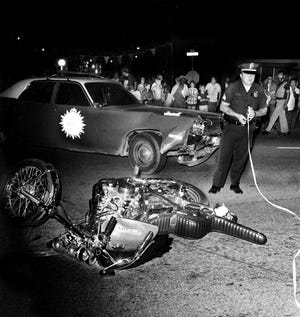 From The Tennessean 1974 archive: A Metro policeman is working the scene of a motorcyclist, attempting to flee police, was killed when his motorcycle collided with a patrol car on Aug. 23, 1974. Little Page Drake Jr., 26, was dead on arrival following the collision which occurred shortly before 9 p.m., according to a hospital spokesman.