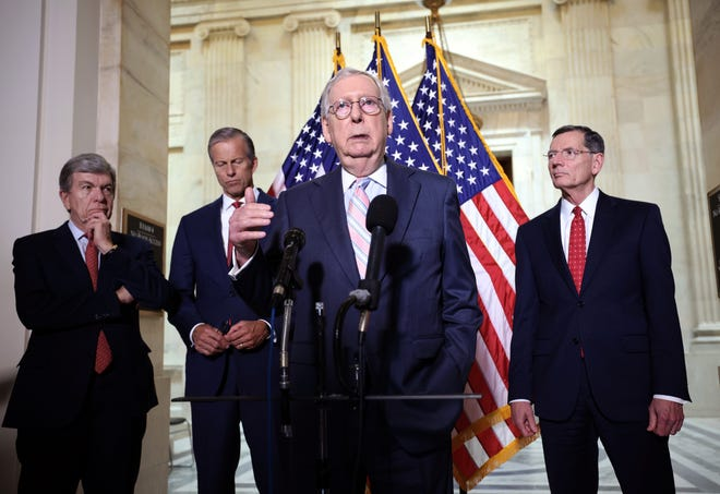 Senate Minority Leader Mitch McConnell, R-Ky., joined by fellow Republican leadership, speaks to reporters on Tuesday.