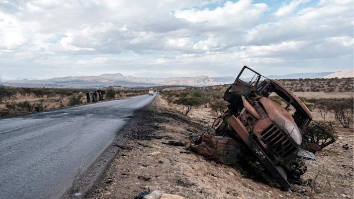A damaged military vehicle lies on the side of the road north of Mekelle, the capital of Tigray on February 26, 2021