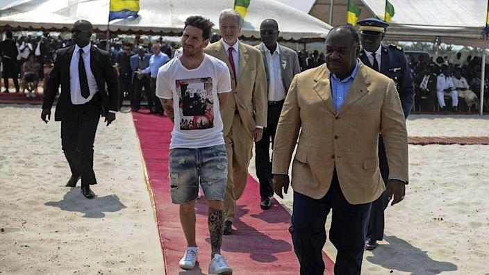 Argentinian soccer player and four-time FIFA Ballon d'Or winner Lionel Messi (C) is given a tour during the start of construction of the Port-Gentil Stadium by the President of Gabon, Ali Bongo Ondimba (R) in the Ntchengue district of Port-Gentil on July 18, 2015. Gabon went on to host the 2017 Africa Cup of Nations soccer tournament.