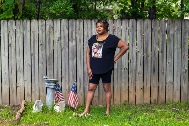 """More than a year since her daughter Shalondra died of COVID-19, Cassandra Rollins still startles when the phone rings, worrying someone else is hurt or has died. Rollins, of Jackson, Mississippi, stands next to a memorial she created after her son died in 2019. Now it's for Shalondra, as well. """"This wound right here, time don't heal it."""""""