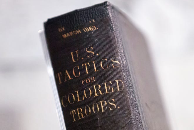 """In this Tuesday, May 7, 2019 photo, a 1863 Training Manual For U.S. Colored Troops is displayed in the new exhibit """"Civil War and Reconstruction: The Battle for Freedom and Equality,""""at the National Constitution Center in Philadelphia."""