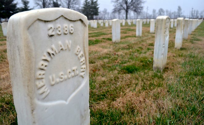 In this Jan 17, 2019 photo, a headstone at Mound City National Cemetery in Mound City, Ill.,  shows the abbreviation U.S.C.T., which stands for United States Colored Troops, the name given to African-American soldiers who served in the Civil War.