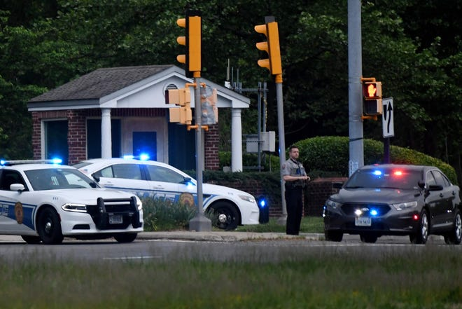 Police cars are pictured outside the CIA headquarters' gate on Monday in Langley, Virginia, after a reported incident involving an armed man with authorities.
