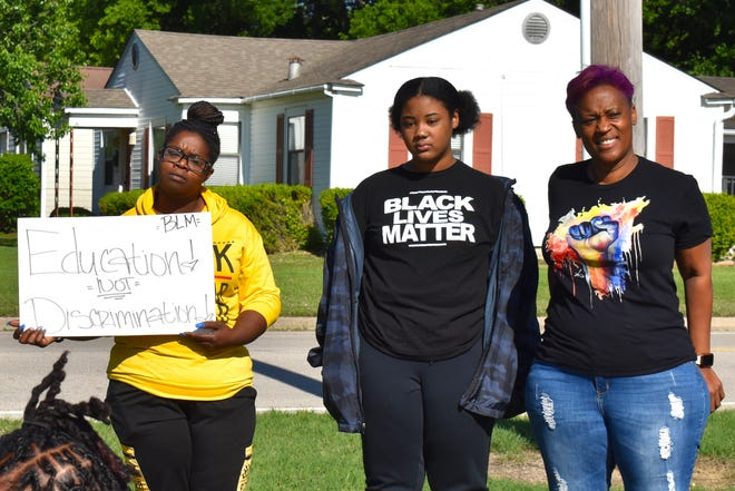 Black Lives Matter supporters stand in front of an Ardmore elementary school Wednesday, May 5, 2021, to protest recent school actions against students wearing Black Lives Matter shirts,