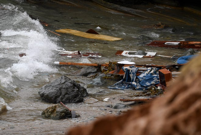 Wreckage and debris from a capsized boat washes ashore at Cabrillo National Monument near where a boat capsized just off the San Diego coast Sunday, May 2, 2021.
