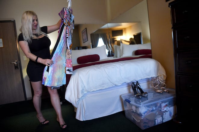 Courtesan Rachel Varga gets her outfits and room ready for clients at the Mustang Ranch Lounge brothel in Storey County on April 30, 2021. Brothels in Nevada reopened Saturday, May 1. Varga has worked at the Mustang Ranch for 5 years.