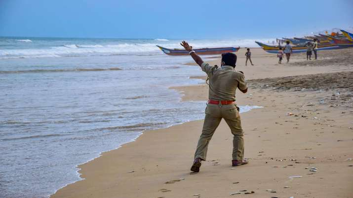 A police person announces cyclone related warnings at a