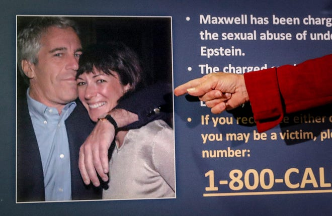 Audrey Strauss, acting U.S. attorney for the Southern District of New York, points to a photo of Jeffrey Epstein and Ghislaine Maxwell during a news conference in New York.