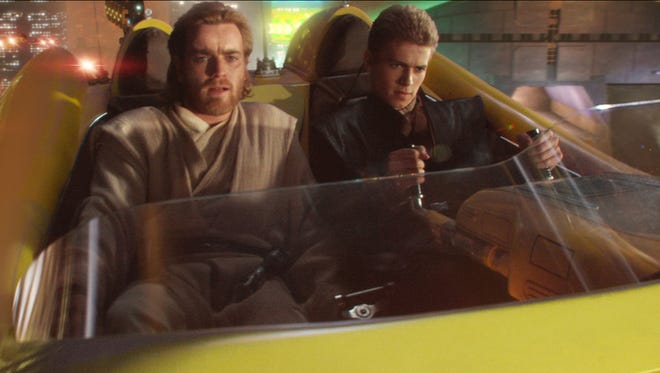 "Obi-Wan Kenobi (Ewan McGregor) and Anakin Skywalker (Hayden Christensen) chase a bounty hunter in ""Attack of the Clones."""