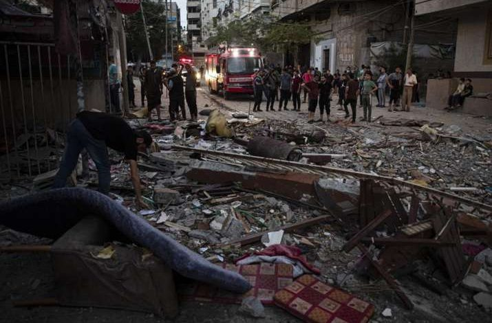 Palestinians search for survivors under the rubble of a