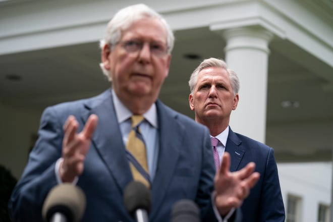 House Minority Leader Kevin McCarthy of Calif., listens as Senate Minority Leader Mitch McConnell of Ky., speaks to reporters outside the White House after a meeting with President Joe Biden, Wednesday, May 12, 2021, in Washington.
