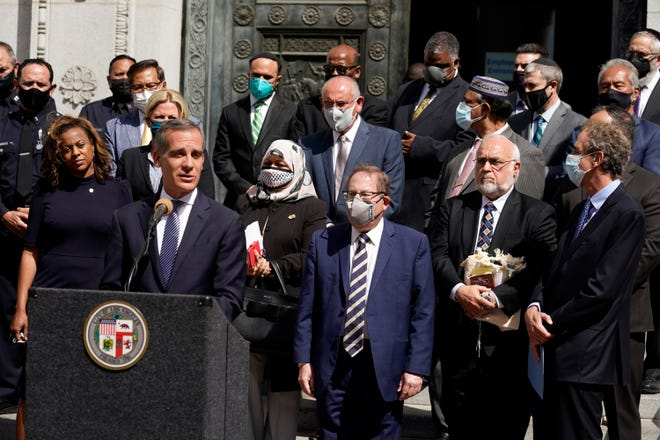 Los Angeles Mayor Eric Garcetti is pictured speaking in front of civic and faith leaders outside City Hall in Los Angeles. Faith and community leaders in Los Angeles called for peace, tolerance and unity in the wake of violence in the city that is being investigated as potential hate crimes