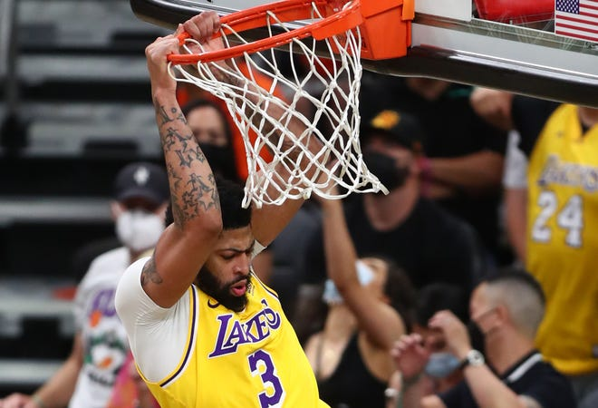 Lakers forward Anthony Davis dunks against the Suns during the second half of Game 2.