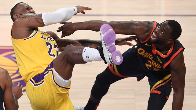 LeBron's winning 3 lifts Lakers over Warriors for No. 7 seed