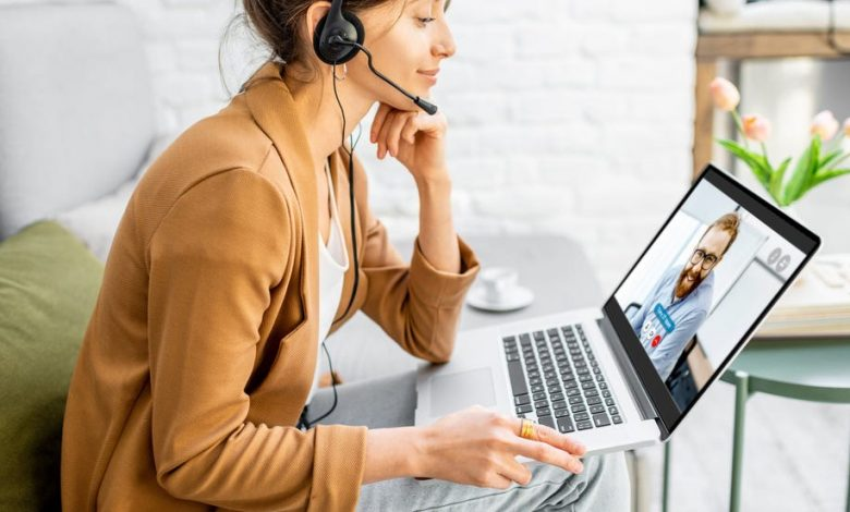 Woman wearing a headset while she works from home